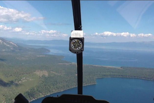 Altimeter shows elevation in a helicopter above Lake Tahoe.