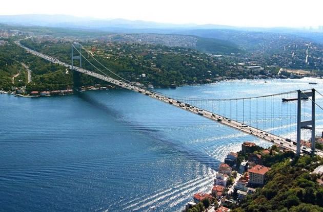 Picturesque houses under the Bosphorus Bridge in Istanbul.