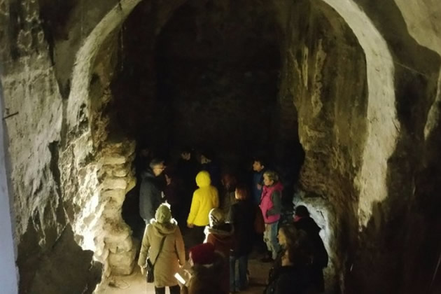 Tourist prepare to enter an ancient tunnel under Istanbul.