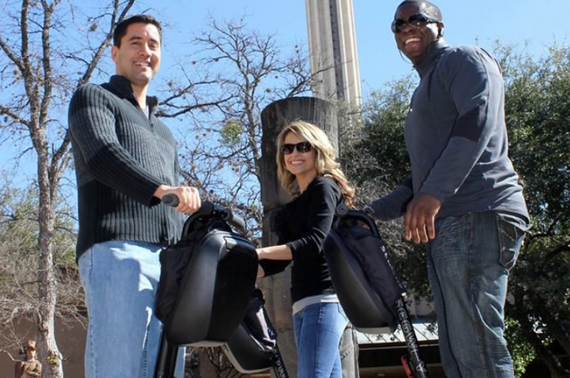 Guests stop for a photo on a Segway tour in San Antonio, Texas.