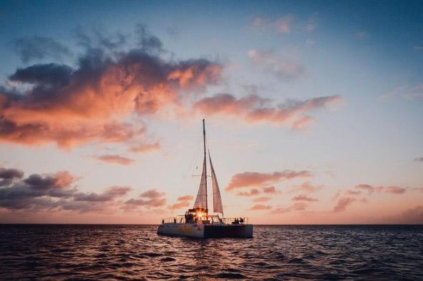 Catamaran at sunset off the coast of Aruba.