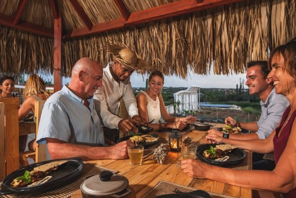 Diners are served fresh fish by an Aruban chef.