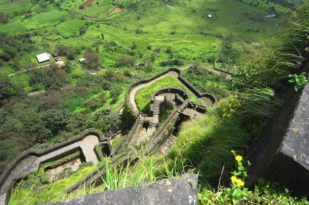 Hilltop view of ancient carved water channels.
