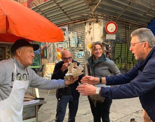 Street vendor offers a sandwich in Palermo.