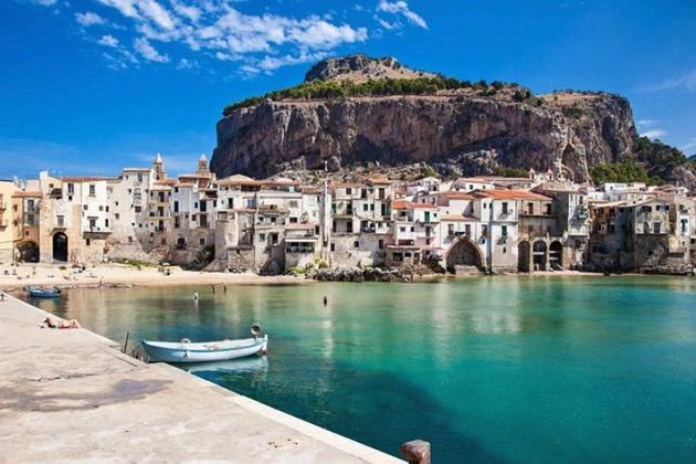 White stone houses along a Sicilian shore.