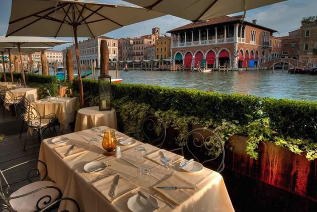 Lunch table along  Venice Grand Canal.