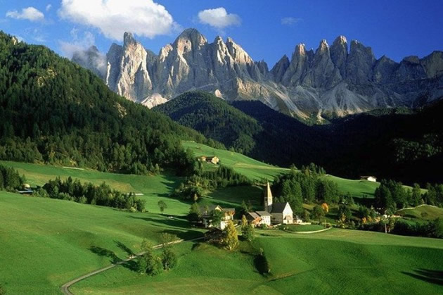 Green valley with Dolomites as a backdrop.